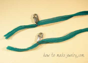 String one end of ribbon through each lobster clasp