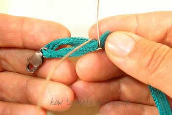 Fold the ribbon over the loop.  Take one of the wire pieces...