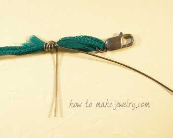 Using your fingers, wrap the wire around and around the ribbon.