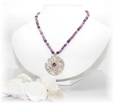 A gorgeous amethyst and silver metal clay necklace!