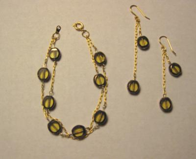 Smoky colored stones linked on a 14kt gold plated chain with drop earrings.