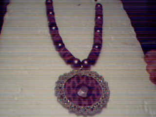A fabric necklace created by Alice~