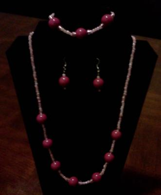 A very nice three-piece jewelry set by Melissa.