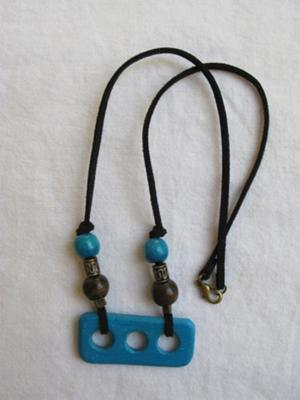 How unique!  A fun necklace made using clay and beads.