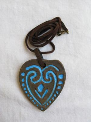 A beautifully crafted heart clay necklace, with a lively blue design.