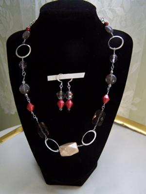 Silver With Black and Red Glass.