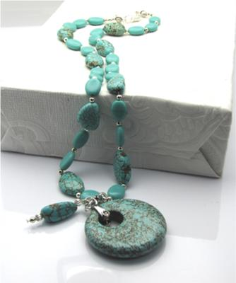 What a cool turquoise pendant!