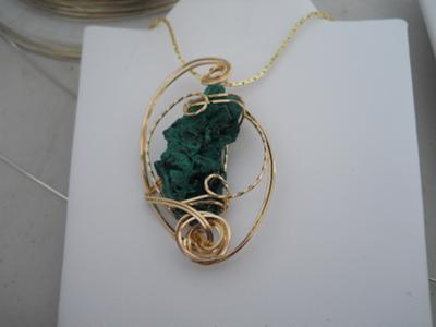 Rose gold wire sculpted raw malachite.
