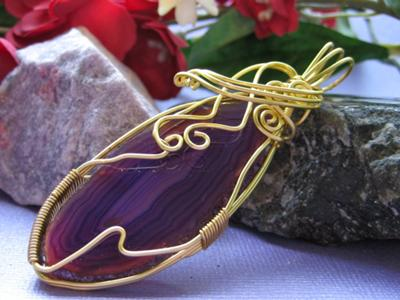 Idyllic manganese agate, wire wrapped in a soft gold.