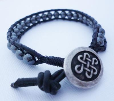 Love the pendant on this beaded leather wrap bracelet!